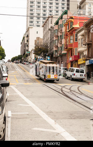 SAN FRANCISCO, CALIFORNIA, July 30th 2018. Cable car traveling down a hill in San Francisco. - Stock Photo