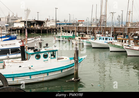 SAN FRANCISCO, CALIFORNIA, July 30th 2018. Small wooden fishing boats tied up near pier 39 in San Francisco. - Stock Photo