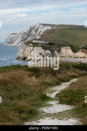 a couple of walkers or hikers on the isle of wight coastal path at freshwater bay, isle of wight. - Stock Photo