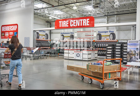 TORONTO, CANADA - AUGUST 15, 2018: Costco Tire Centre. Costco, is an American corporation which operates a chain of membership-only warehouse clubs. - Stock Photo