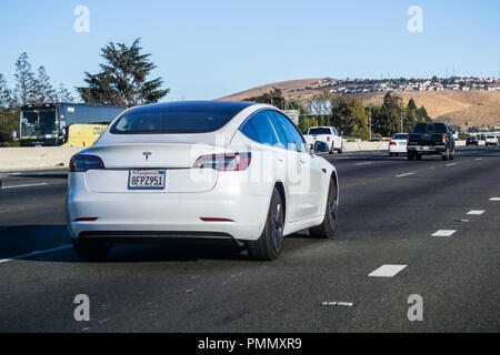 September 8, 2018 San Jose / CA / USA - White Tesla Model S driving on a street in Silicon Valley, south San Francisco bay area - Stock Photo