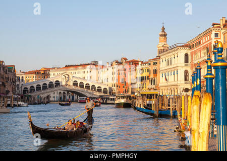 Tourists enjoy a gondola ride at dusk, sunset, evening, Grand Canal, Venice, Veneto, Italy - Stock Photo