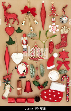 Christmas tree retro decorations, ornaments and symbols with holly, ivy, fir and mistleoe on wrapping paper background. - Stock Photo