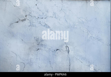 cracked concrete wall covered with gray cement surface as background - Stock Photo
