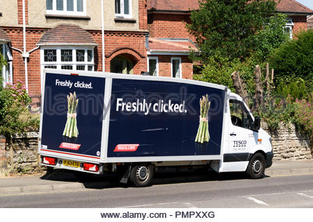 A Tesco delivery van parked at the roadside, Higham Ferrers, Northamptonshire, England, UK - Stock Photo
