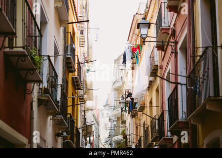 Looking up at balconies and washing lines on a typical Italian urban city street