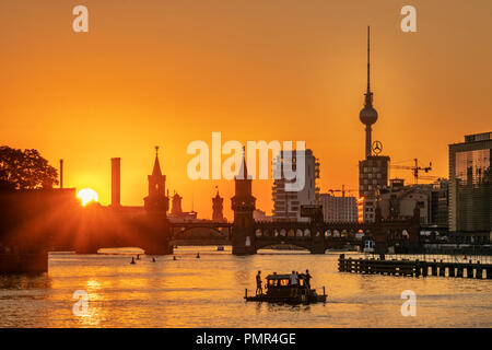 Sunset at river Spree, Oberbaum bridge, Alex TV tower, Friedrichshain-Kreuzberg, Berlin - Stock Photo