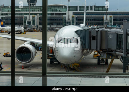 Munich, Germany - August 30, 2018: A Lufthansa Airbus A350 parked at a finger at Terminal 2 of Franz Josef Strauss airport in Munich - Stock Photo