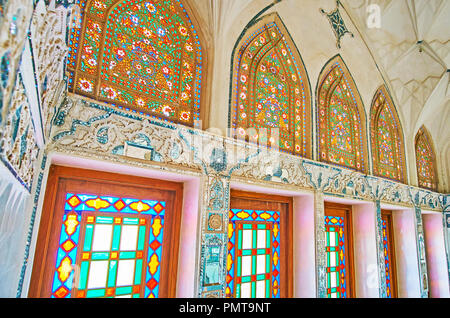 KASHAN, IRAN - OCTOBER 22, 2017: The masterpiece mirrorwork and stained glass windows in Mirror Hall of Abbasi House - historical mansion, serving as  - Stock Photo