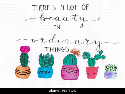 'There's a lot of beauty in ordinary things' hand lettering motivational quote with colorful watercolor paintings of cactuses - Stock Photo