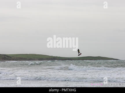 Garrettstown, Cork, Ireland. 19th September, 2018. Kitesurfer Ramunas Kaskelis from Carrigtwohill is carried high in the air while surfing in the high winds during Storm Ali  at Garrettstown beach Co. Cork, Ireland. - Stock Photo