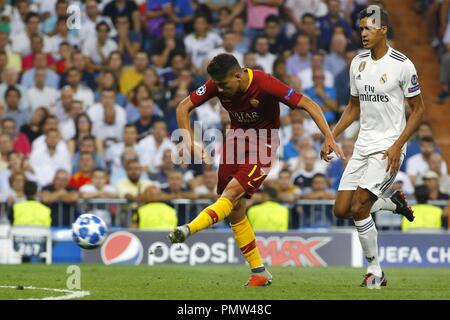 Real Madrid's Varane and AS Roma's midfielder Cengiz Under vie for the ball during the UEFA Champions League first round groups phase match between Real Madrid and AS Roma at the Santiago Bernabeu stadium, in Madrid, Community of Madrid, Spain, 19 September 2018. EFE/JP Gandul - Stock Photo