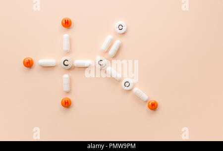 Formula from pills and tablets with chemical elements on a solid background. - Stock Photo
