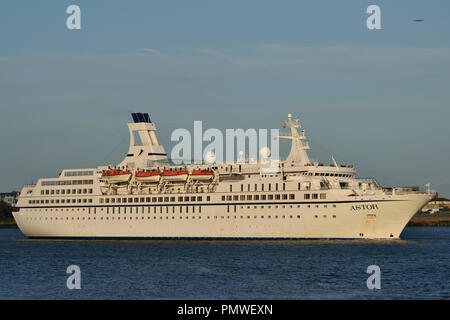 Cruise Ship Astor heads up the River Thames to London in the late afternoon sunshine - Stock Photo