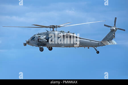 USNAVY MH-60 Seahawk helicopter on gunnery training exercise at Tain range, flying out from the RAF base at Lossiemouth in Moray, Scotland. - Stock Photo