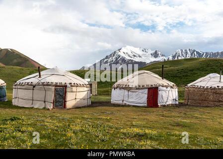 Yurt camp in the Peak Lenin valley, Kyrgyzstan - Stock Photo