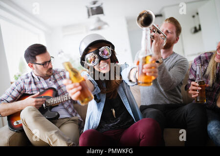 Group of friends having fun, partying and drinking - Stock Photo