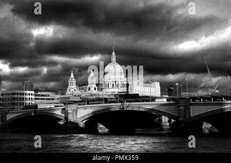 London, England, UK. St Paul's Cathedral, River Thames and Blackfriars Bridge on a dramatic cloudy day in December - Stock Photo