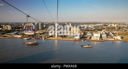 London, England, UK - September 2, 2018: Crossing the River Thames on the Emirates Air Line Cable Car gives travellers views of the fast changing Roya - Stock Photo