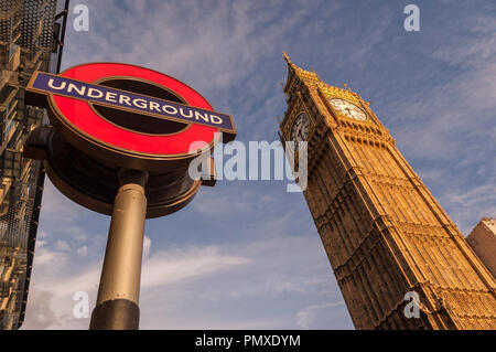 London, England, UK - September 18, 2010: The Elizabeth clock tower, home of Big Ben, rises from the Houses of Parliament beside Westminster tube stat - Stock Photo