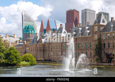 City center view of The Hague in Netherlands with pond Hofvijver and historical Binnenhof in foreground and modern skyscrapers in background - Stock Photo