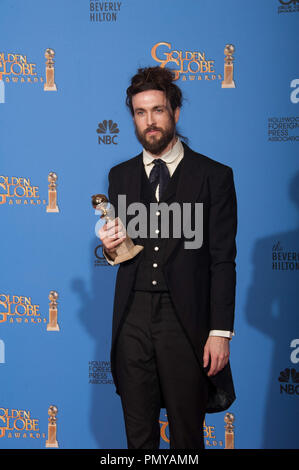 "After winning the category of BEST ORIGINAL SCORE – MOTION PICTURE for ""ALL IS LOST"", Alex Ebert poses with the award backstage in the press room at the 71st Annual Golden Globe Awards at the Beverly Hilton in Beverly Hills, CA on Sunday, January 12, 2014.  File Reference # 32222_348JRC  For Editorial Use Only -  All Rights Reserved - Stock Photo"