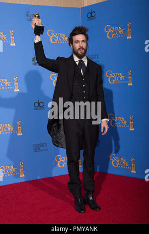 "After winning the category of BEST ORIGINAL SCORE – MOTION PICTURE for ""ALL IS LOST"", Alex Ebert poses with the award backstage in the press room at the 71st Annual Golden Globe Awards at the Beverly Hilton in Beverly Hills, CA on Sunday, January 12, 2014.  File Reference # 32222_366JRC  For Editorial Use Only -  All Rights Reserved - Stock Photo"