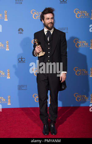 "After winning the category of BEST ORIGINAL SCORE – MOTION PICTURE for ""ALL IS LOST"", Alex Ebert poses with the award backstage in the press room at the 71st Annual Golden Globe Awards at the Beverly Hilton in Beverly Hills, CA on Sunday, January 12, 2014.  File Reference # 32222_367JRC  For Editorial Use Only -  All Rights Reserved - Stock Photo"