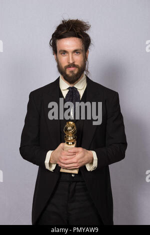 "After winning the category of BEST ORIGINAL SCORE – MOTION PICTURE for ""ALL IS LOST"", Alex Ebert poses with the award backstage in the press room at the 71st Annual Golden Globe Awards at the Beverly Hilton in Beverly Hills, CA on Sunday, January 12, 2014.  File Reference # 32222_442JRC  For Editorial Use Only -  All Rights Reserved - Stock Photo"