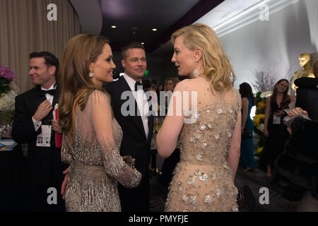 """After winning the category Performance by an actress in a leading role for her role in """"Blue Jasmine"""", actress Cate Blanchett talks with presenters Angelina Jolie and Brad Pitt.  The Oscars® are presented live on ABC from the Dolby® Theatre in Hollywood, CA Sunday, March 2, 2014.  File Reference # 32268_412  For Editorial Use Only -  All Rights Reserved - Stock Photo"""