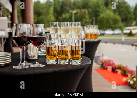 Glasses with juice, glasses with red wine on a buffet table - Stock Photo