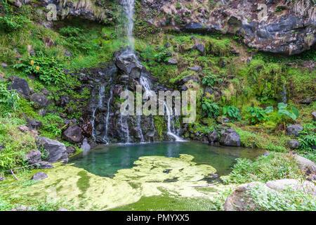 waterfall cascading down to viola beach on the sao miguel island azores Praia da Viola - Stock Photo