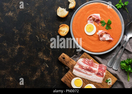 Traditional spanish andalusian tomato cream soup - salmorejo.Vegetarian tomato soup. The view from the top,flat lay - Stock Photo