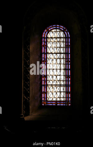 Lisbon, Portugal - March 5, 2013: One of the side windows of the monastery of Jeronimos painted in a simple way with motifs relating to the sea and di - Stock Photo