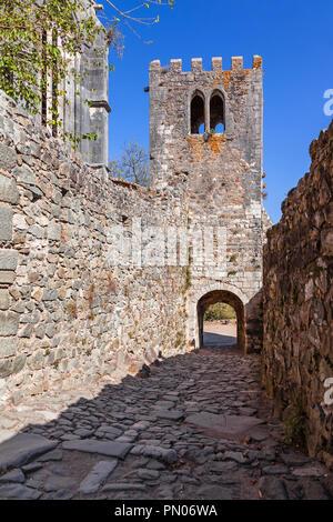 Leiria, Portugal - October 10, 2017: Bell Tower of the Santa Maria da Pena Church aka Nossa Senhora da Pena, and entrance of the Castle of Leiria - Stock Photo