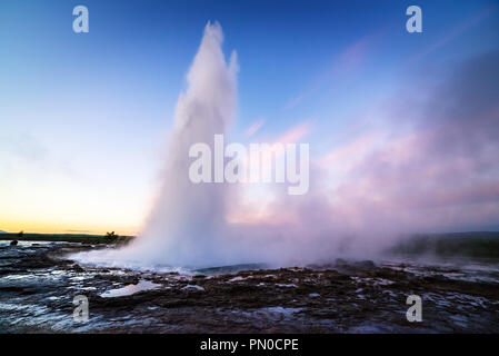 Strokkur geyser eruption. Golden circle Iceland. Famous natural and tourist attraction in valley Haukadalur - Stock Photo