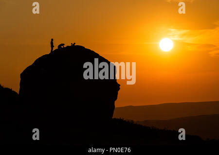 Climbers on the Cow and Calf rocks. Ilkley. England - Stock Photo