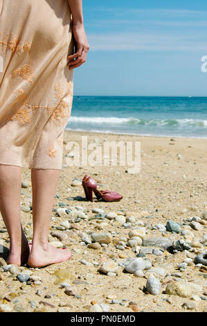 A woman standing on a beach in Montauk New York - Stock Photo