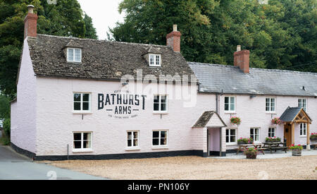 Bathurst Arms pub alongside the River Churn in the cotswold village of North Cerney, Gloucestershire, England - Stock Photo