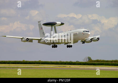 US Air Force Boeing E-3 Sentry AWACS plane landing at RAF Waddington. Airborne early warning and control (AEW&C) jet aircraft based on 707 - Stock Photo