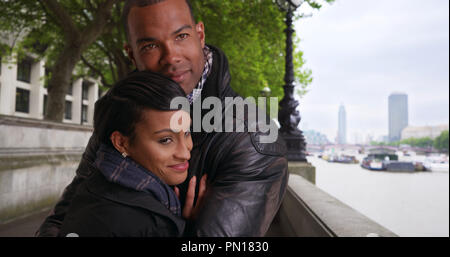 6d8b8f301 Warm loving black couple embrace each other tenderly outside by ...