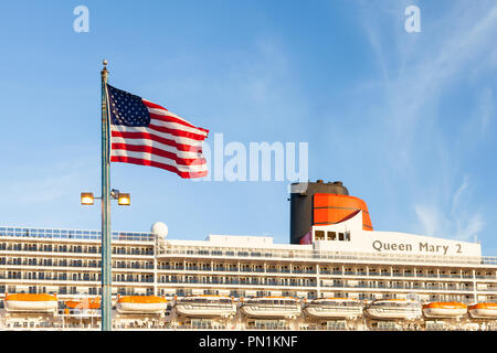 Cunard cruise liner Queen Mary 2 is pictured docked in Brooklyn, New York.  The liner is the flagship of the Cunard fleet. - Stock Photo
