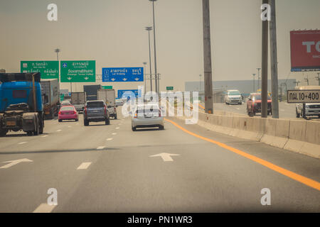 Bangkok, Thailand - May 23, 2017: Drivers on the lanes with high speed cars on the motorway from Bangkok to Chonburi province. - Stock Photo