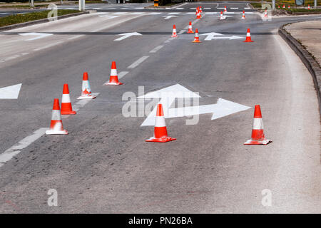 Work on the road. Street signs and road marking. Traffic signs for signaling. Road maintenance, under construction sign and traffic cones on road. - Stock Photo