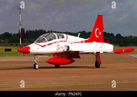 Turkish Stars Türk Yıldızları Turkish Air Force aerobatic demonstration team taxiing in at RIAT Royal International Air Tattoo RAF Fairford. Jet plane - Stock Photo