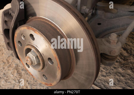 Brake disc, caliper and ball joint of a car - Stock Photo