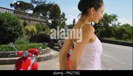 Close up of attractive Latina tourist in sundress on  street in Florence Italy - Stock Photo
