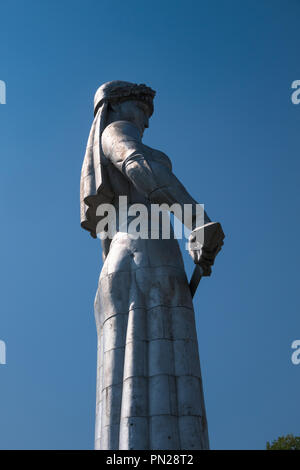 Looking up towards the aluminium statue of Mother Georgia who looks over the city of Tbilisi, Georgia. - Stock Photo