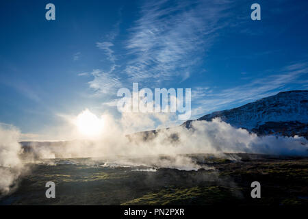 Geysir Geothermal Area - steam rising from a field of hot pools and water spouts at one of Iceland's most famous geysers - Stock Photo