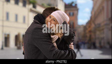 Loving young couple exploring Roman streets hugging each other - Stock Photo